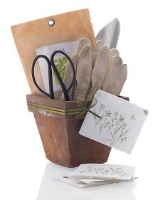 Garden-Variety Gift ...A flowerpot filled with garden supplies, such as a spade, shears, seeds,  and gloves, makes a good gift for any friend with a green thumb.