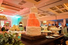 Dessert table with 4 layer cake ruffled and red watercolor accents. LVL Weddings & Events // Photography: Nathan Jaffan Photography// Floral: Bloomers La Jolla // Venue: Estancia La Jolla Hotel & Spa // DJ / Ceremony Musician:  Kevin Miso // Cake: Sweet Lydia's of San Diego // Photo Booth: Shutterbooth // Dress: Katie May // Shoes: Badgley Mischka