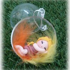 Boule de noël transparente poupée dormeuse