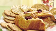 Enjoy crackers with this baked brie made with raspberry and Pillsbury® refrigerated crescent dinner rolls that is ready in an hour – perfect for an appetizer.
