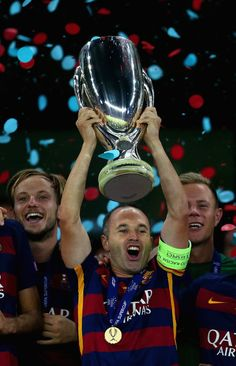 Andres Iniesta of Barcelona lifts the UEFA Cup trophy as Barcelona celebrate victoy during the UEFA Super Cup between Barcelona and Sevilla FC at Dinamo Arena on August 11, 2015 in Tbilisi, Georgia.