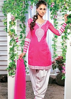 Pink cotton kameez is embellished with resham and patch border. Contrasting white salwar and dupatta .  Price £59 Sizes:  S - XXL