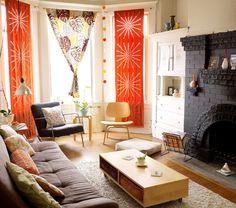 black fireplace + warm & light walls + hanging shop lights + colorful & cozy