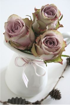 Not sure, but these look like Sterling Silver Roses...one of my favorites.