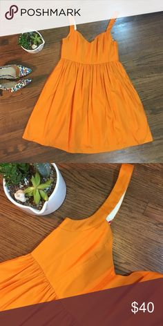 Bright Orange Fit & Flare Dress Stop traffic in this incredible Ali Ro dress in PERFECT condition. 👌👌 Beautiful silky fabric in vibrant tangerine, pockets and a structured bodice with boning to keep everything in place while you're dancing! 💃🏼Fully lined and in excellent used condition (EUC). Questions and reasonable offers welcome!! Ali Ro Dresses Mini