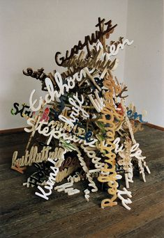 This sculpture by artist Jean-Luc Cornec is called Scheiterhaufen-Zungenbrecher, which means funeral pyre of tongue-twisters. It reminds me of this sculpture by Cleas Oldenburg, which I referred to in an earlier post here. Lego Words, Sculpture Art, Sculptures, 3d Typography, Lettering, Cardboard Letters, Shop Signage, Tongue Twisters, Environmental Graphic Design
