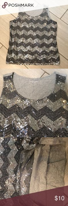 Chevron print comfy cotton sequin top This is an adorable top and some of the things I 😍 about it is first it's 💯 cotton and second it has a cotton layer between the sequin front and your skin so the cotton lays against you not the sequins. I 😍 Coldwater Creek clothes and they are quality. It is missing two sequins as you can see in the picture upclose. It isn't noticeable when wearing and isn't fraying or coming apart because each sequin is stitched on separately. From a smoke free home…