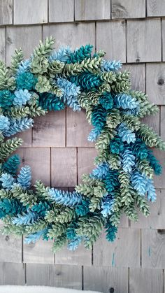 Could also do this in red and green for Christmas.Large Pinecone Wreath In Blue and Greens by scarletsmile on Etsy Pine Cone Art, Pine Cone Crafts, Wreath Crafts, Diy Wreath, Pine Cones, Holiday Crafts, Diy Crafts, Holiday Decor, Wreath Ideas