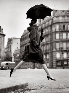 Henri Cartier Bresson woman with umbrella. Cute shoes! I could do that. Those heels are small enough that the chance of twisting an ankle is pretty slim.