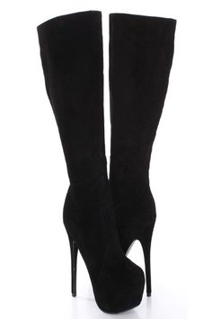 Rock out with these sexy AMIclubwear platform boots! They are sure to turn heads in any occasion! They will look super hot paired with your favorite skinnies or dress. Make sure you add this collection to your closet, it definitely is a must have! The features include faux suede upper with stitched detailing, side zipper closure, almond shaped closed toe, smooth lining, and cushioned footbed. Approximately 6 inch heels, 2 inch hidden platforms, 16 inch circumference, and 17 inch shaft.