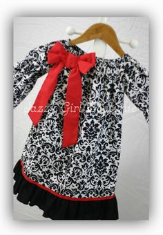 Girls Christmas Peasant Dress in a Black and White Damask print with a large red bow and ribbon accents.  Perfect for those holiday pictures!