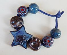 Set bead-star black ceramic. By Mª Carmen Rodriguez Martinez ( Majoyoal ) https://www.facebook.com/groups/CeramicArtBeadMarket