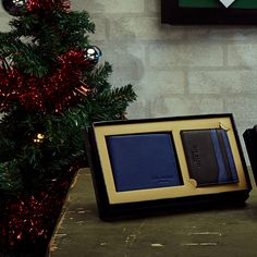 SHOP FOR HIM: The perfect stocking filler, Ted's wallets are perfect for him to store all his lucky pennies. Compact in size and ideal for tucking in his jacket pocket, this two-tone delight ensures he get to hold his cards close to his chest.