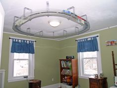 Train set mounted on the ceiling.    Google Image Result for http://165walthamstreetnewton.com/sitebuildercontent/sitebuilderpictures/PicturesByAna/TrainSet.jpg