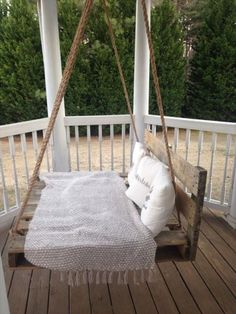 If you want to turn a wooden pallet swing into a sturdy reading spot, add a slatted back for support. Click through more cool DIY outdoor swings.
