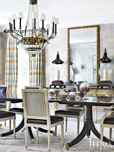 This dining room shimmers in pewter wallpaper, complimented by plaid silk curtains and chocolate-brown leather chairs.