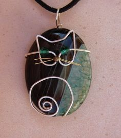 """Wire Cat on Green Agate Pendant by jillmh123 on Etsy. This one is sold, the link opens the """"cats"""" section of her shop :3"""