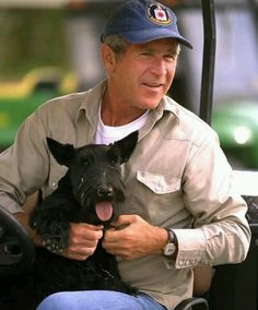 President George W. Bush with his beloved pet, Barney.