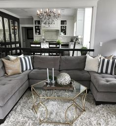 Change up the gray couch with and chic black and white striped accents