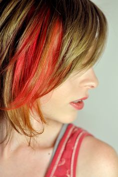 Love the idea of red and orange in natural hair. Might think of doing this  in the summer.
