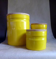 Danish Modern Canister Set, Bright yellow metal with Wood lids. $29.95, via RebeccasVGVintage Etsy.