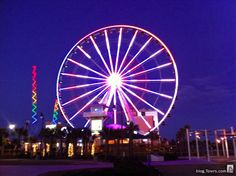Carolina Beach, NC Ferris Wheel and other Rides on the Ocean.
