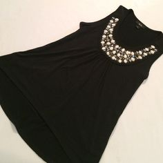"Beautiful beaded Black top Sz s High low top. Top measures 16"" in front & 25"" in back. 85% polyester and 5% spandex BCX Tops"