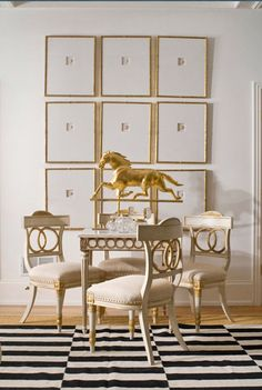 Beautifully co-ordinated dining room in shades of white, cream and gold with ever omnipotent black and white flooring. Clever display of wall art brings an edge of modernity.