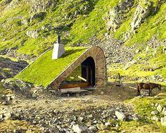Snohetta, isolated cabin, Norway, Bjellandsbu - Åkrafjorden, angular green roof, local materials, cozy interiors,