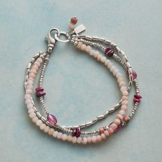 Fond of Pink Bracelet: In this 'Fond Of Pink' triple-strand bracelet, pink opal, rhodonite and tourmaline cozy up with ruby and sterling silver beads. Handmade in USA with sterling lobster clasp. Hamsa Necklace, Gold Bar Necklace, Cluster Necklace, Lariat Necklace, Colar Lariat, Handmade Bracelets, Handmade Jewelry, Diy Jewelry, Bead Jewelry