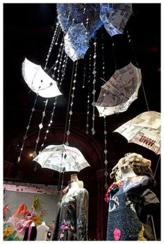 Brilliant idea for a fashion show or viewing. objects as decorations (not umbrellas>=?)
