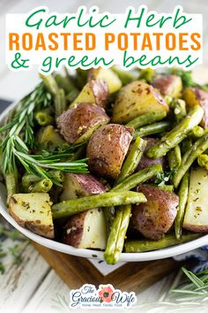 Buttery, crispy red potatoes and fresh green beans tossed with garlic and herbs make these Garlic Herb Roasted Potatoes and Green Beans a simple, elegant, and flavorful side dish for any meal. Simple ingredients and a huge punch of warm buttery flavor make these garlic herb roasted potatoes and green beans a side dish you'll make again and again. | @graciouswife #summersidedishes #easypotlucksides #beefsidedishes #steaksidedishes