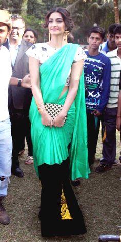 regal. Love this sari soooooooo elegant.
