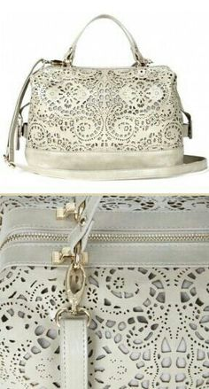 I don't know if I'd ever buy a white purse (for same reason I hesitate all white sneakers/shoes, too easy to show any scuff and such), but i can't deny this is pretty