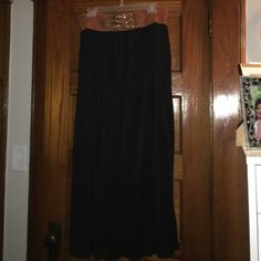 Black pleated maxi skirt with elastic belt. Black pleated maxi skirt with elastic belt. Approx 39 inches from belt to hem. Lined. Never worn. Skirts Maxi