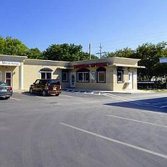 81933 Overseas Hwy, Islamorada, FL Commercial zoning in downtown Islamorada! Great highway visibility! 100 ft. of highway frontage with entrances from US 1 and Old Highway. 2 separate buildings, larger building was expanded in 2005 and has 2118 sq.ft. plus 504 sq.ft. of patio. Smaller building was built in 1981 with 585 sq.ft. X flood zone and ample parking for customers. Good rental income.