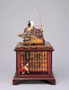 Japanese Karakuri ningyō by TANAKA Hisashige (1779-1881) - a mechanized puppets or automata and this one is called Yumi-biki Douji (archer boy)