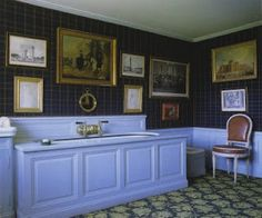 Nice baronial feel to this vanity and wonderful gallery wall against the tartan.