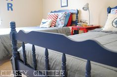 Navy blue twin beds in a vintage airplane room