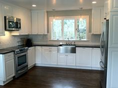 Appliances: Kitchenaid Architect Series Cabinets: Ikea Akurum with Lidingo White Front Walls: Benjamin Moore Gray Wisp