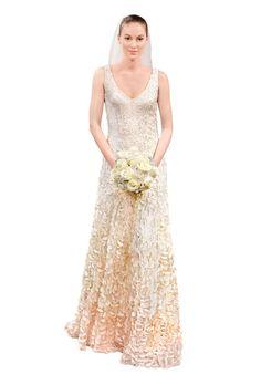 Brides.com: Spring 2014 Wedding Dress Trends. Petal-embroidered wedding dress, Theia  See more Theia wedding dresses.
