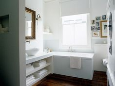 So, this won't really work for my tub/sink setup, but I like the look. Streamlined, good use of space, open shelving under sink, tall tub, pretty floor...
