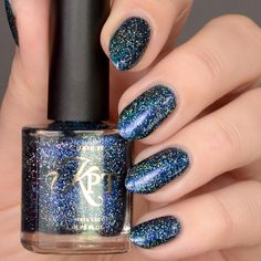 Nalani by KPT Nail Lacquer - A rich navy blue jelly polish filled with blue and purple color shifting shimmers with the addition of sliver and rainbow holographic glitters. Usage: Polish is best worn alone in 2-3 coats to reach opacity Net Wt: .5O fl oz ℮ / 15 mlBIG5FREE   vegan