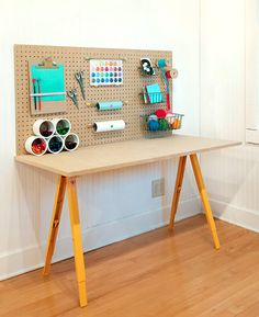 Kids Craft Desk - Love the simplicity of this; affordable, too.  I would have to add bins and baskets for other supplies, but this is a great starting point.