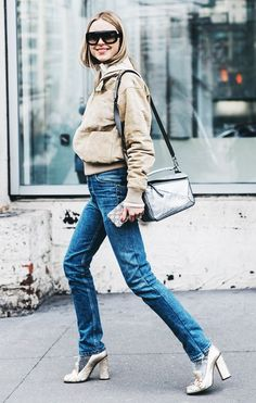 Pernille Teisbæk waers a suede bomber jacket, rectangular sunglasses, jeans, a Loewe Puzzle bag, and gold Gucci pumps