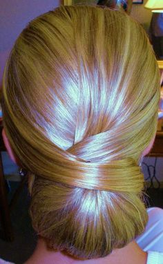 Elegant Low Bun~pretty! I think my bridesmaids would look great with this :)