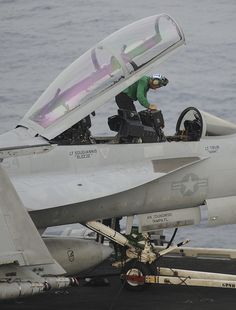 """GULF OF OMAN (June 15, 2013) – An aviation boatswain's mate (equipment) runs checks on an F/A-18F Super Hornet assigned to the """"Black Knights"""" of Strike Fighter Squadron (VFA) 154 on the flight deck of the aircraft carrier USS Nimitz (CVN 68). Nimitz Strike Group is deployed to the U.S. 5th Fleet area of responsibility conducting maritime security operations, theater security cooperation efforts and support missions for Operation Enduring Freedom. (U.S. Navy Photo by Chris Bartlett/Released)"""