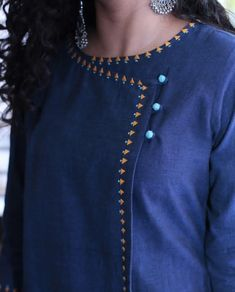 Detailing with embroidery and buttons
