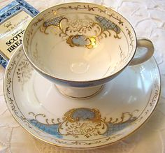 Elegant pastel blue gold and white tea cup with saucer