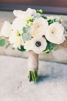 anemone and garden rose bouquet, photo by Lisa Poggi http://ruffledblog.com/tuscany-destination-wedding #flowers #weddingbouquet